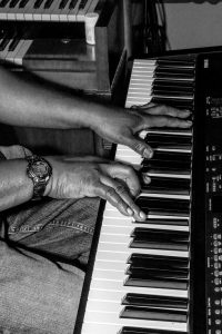 The hands of Jeffrey Scott Lawrence playing piano