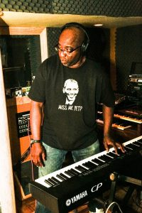 Jeffrey Scott Lawrence getting the sound right on his piano keyboard